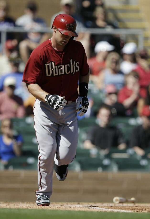 Arizona Diamondbacks' Paul Goldschmidt, a graduate of The Woodlands, heads to first after walking against the Colorado Rockies Wednesday in Scottsdale, Ariz. Photo: Darron Cummings