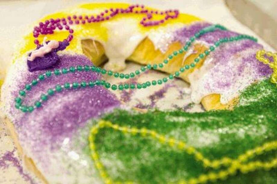 A finished Mardi Gras king cake waits to be boxed up for customers at Montgomery Bakehouse in Conroe Tuesday. Photo: Jason Fochtman / Conroe Courier / HCN