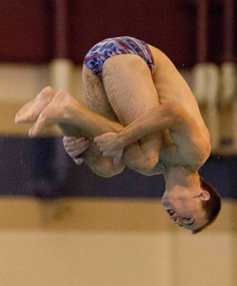Oak Ridge's Anton Hoherz competes during the Region 4-6A Swimming and Diving Championships in Shenandoah. Photo: Jason Fochtman