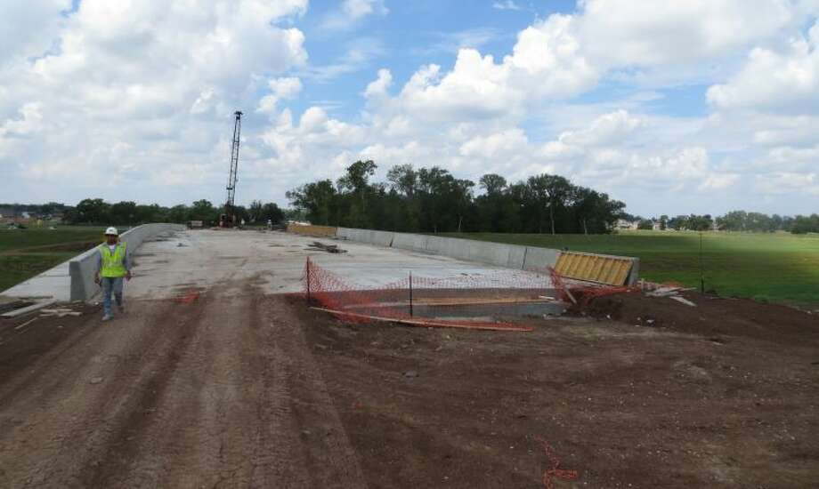 Construction continues on a bridge over the Flat Bank Creek Diversion Channel which upon completion will connect the Fort Bend master-planned communities of  Sienna Plantation and Riverstone. Photo: Submitted Photo