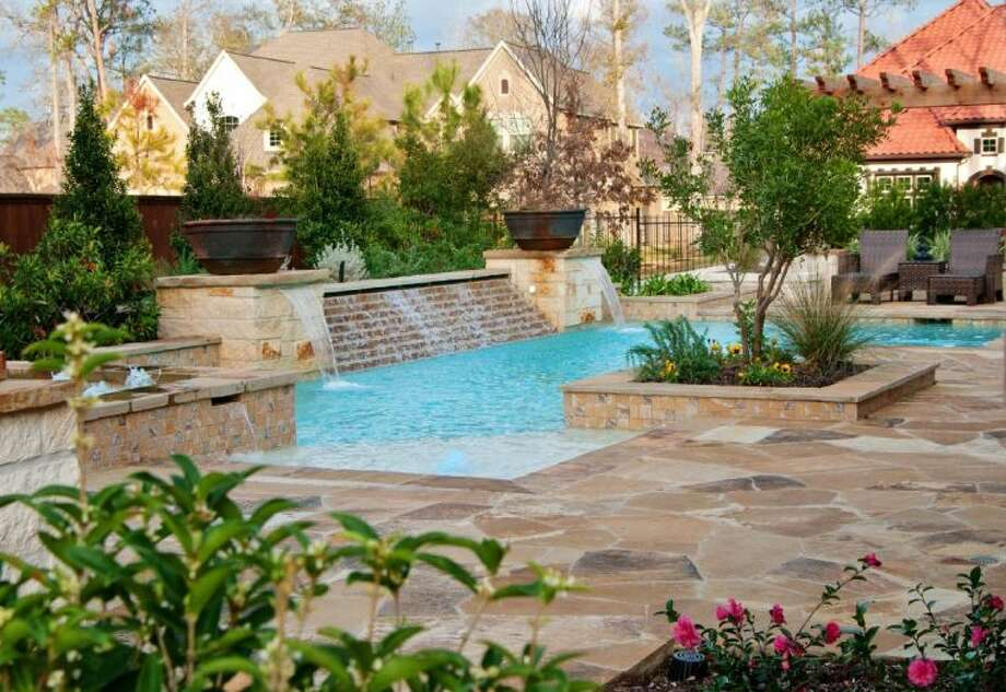A pool and waterfall scene from Stewart Land Designs. Photo: TIFFANYMN@EAJeff Baird