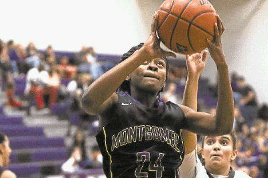 Montgomery's Da'Trinique Jones (24) goes for a layup during a game against Willis earlier this season. Photo: Michael Minasi