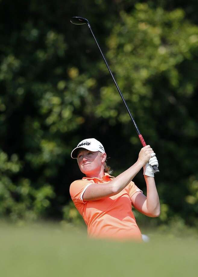 Stacy Lewis tees off on the third hole during the third round of the HSBC Women's Championship on Saturday in Singapore. Photo: Wong Maye-E
