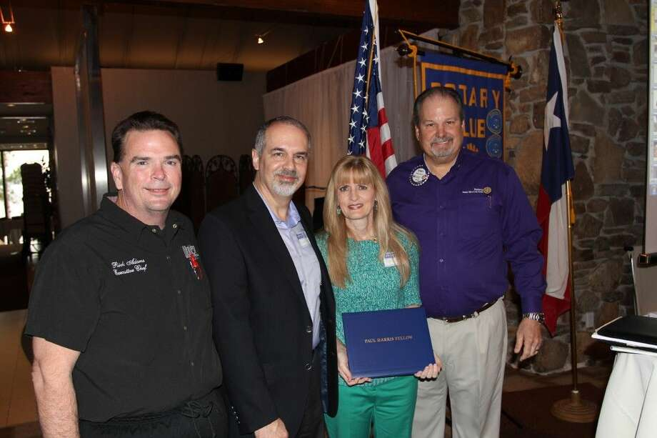 Montgomery High School teacher and Interact Representative Karen Hill was honored as a new Paul Harris Fellow by The Rotary Club of Lake Conroe for her work with the Interact Club. Pictured are: Rotarian Rick Adams, Montgomery High School Interact Rep from The Rotary Club of Lake Conroe, Scott Hill (husband of Karen), Paul Harris Fellow recipient Karen Hill and Rotarian Bobby Morris.