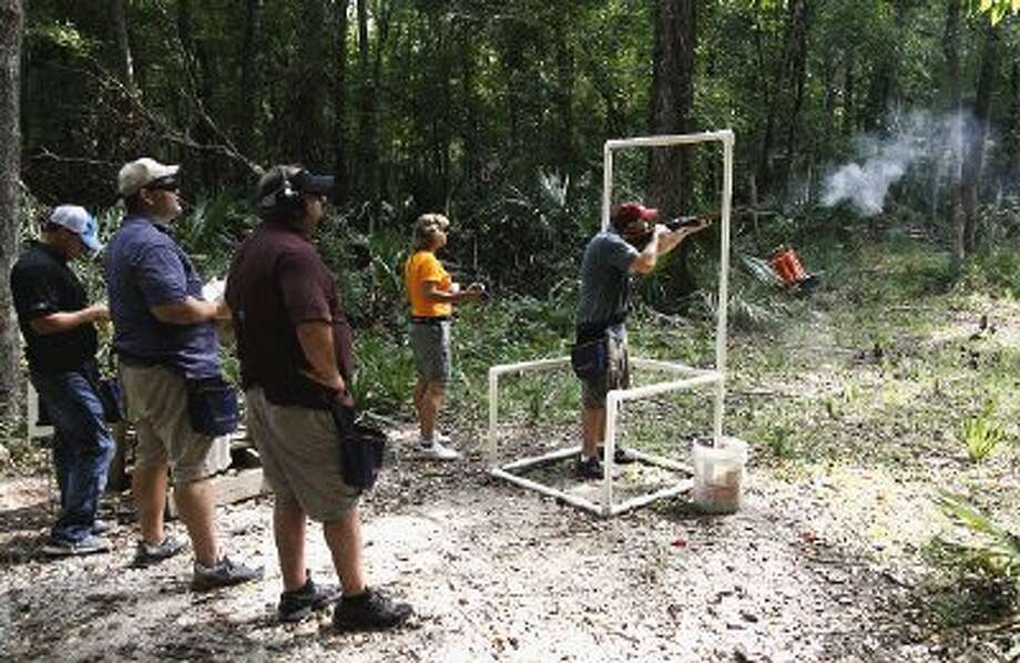 John Smith of Houston takes aim at sporting clays during the 2013 Shoot Out Texas on Thursday benefiting the Montgomery County Food Bank.