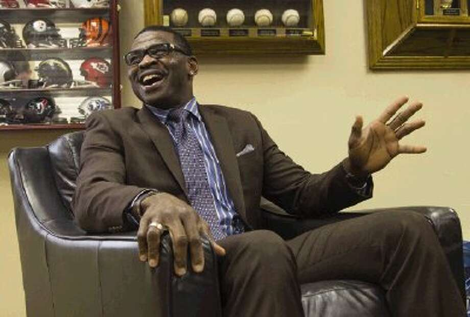 Former Dallas Cowboys' wide receiver Michael Irvin speaks during a Men's Power Lunch Monday at the First Baptist Church in Conroe. Irvin is a winner of three Super Bowls and in 2007 was inducted into the Pro Football Hall of Fame. Photo: Staff Photo By Ana Ramirez / The Conroe Courier