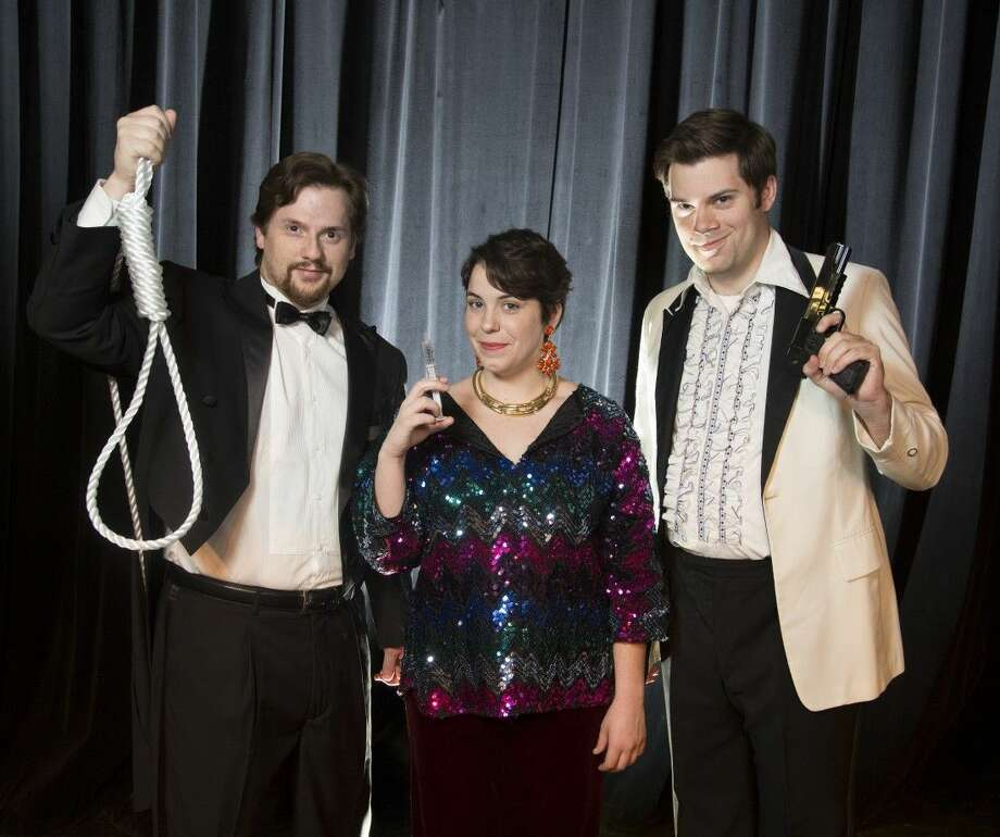 "Pictured from left to right are Brian Heaton as Mitch Lovell, Sarah Walker as Arlene Miller and Nick Hough as Paul Miller. They star in The Players Theatre Company's ""Murder at the Howard Johnson's"" at the Owen Theatre. The show has its final weekend with shows Friday, Saturday and Sunday."