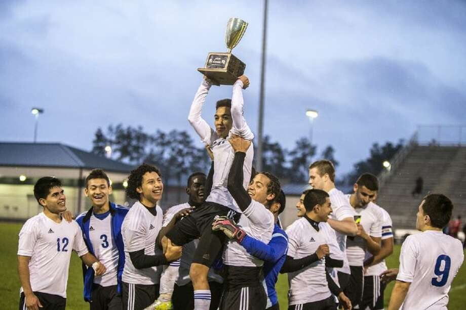 Teammates hold up Luis Arreola as he shows off the Battle Line on 59 trophy following New Caney's 1-0 victory over Porter on Wednesday at Don Ford Stadium in Porter. Photo: ANDREW BUCKLEY