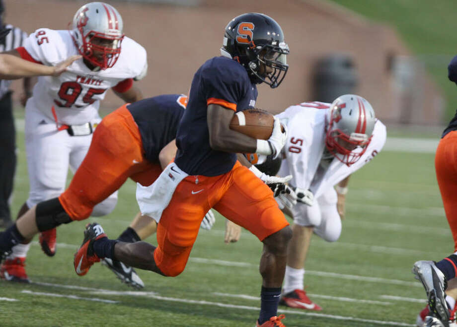 Seven Lakes' Bryan Moore runs against Travis during a 2013 non-district game at Rhodes Stadium. Moore caught touchdown passes of 41, 56 and 93 yards in a 43-21 rout of Clear Falls. Photo: Staff Photo By Alan Warren
