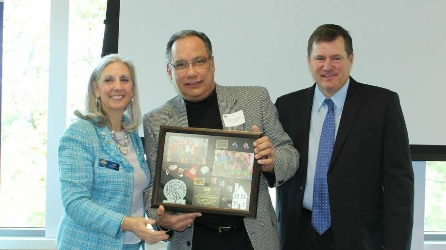 Willis City Manager Hector Forestier, center, received the Volunteer of the Year award from the Montgomery County United Way. Forestier stands with MCUW President Julie Martineau, left, and 2014 MCUW Board Chair Bob Abendschein. Photo: Picasa
