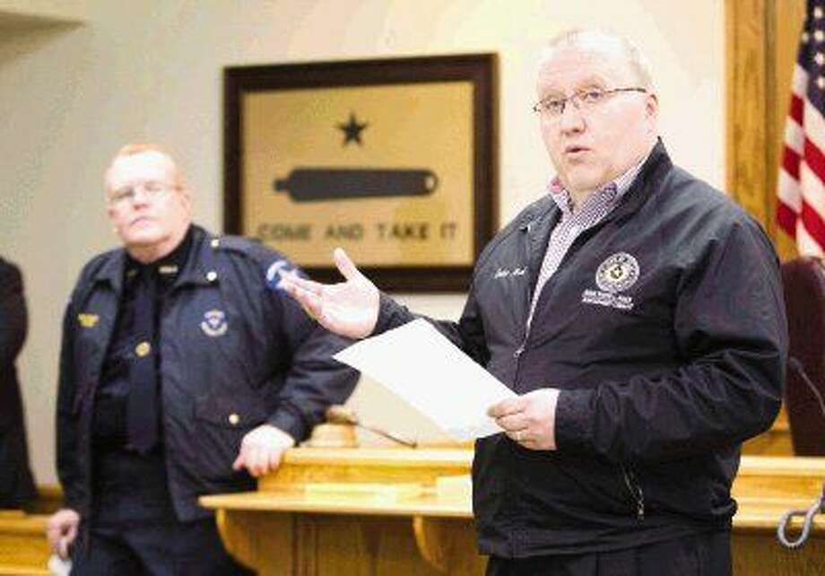 Precinct 1 Justice of the Peace Wayne Mack talks to law enforcement before the start of the Precinct 1 warrant roundup Wednesday. Photo: Jason Fochtman