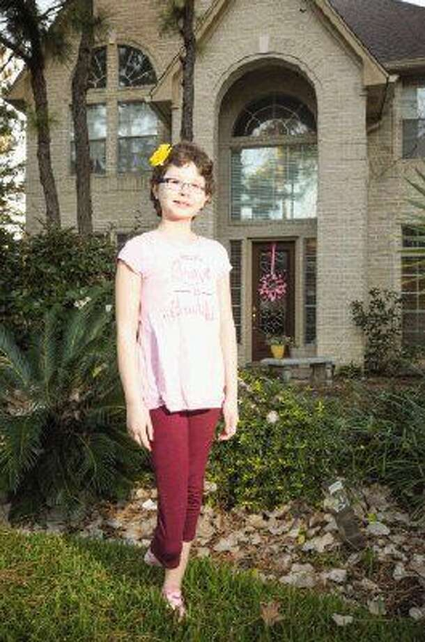 Sally K. Ride Elementary fourth-grader Elise Robinson, 9, has been selected as The Woodlands' ambassador for the St. Baldrick's Foundation, which seeks to conquer childhood cancer. Elise, diagnosed with osteosarcoma in September 2014, was declared NED — No Evidence of Cancer on June 1, 2015. Elise will be formally introduced as the ambassador at a chili cook-off benefiting St. Baldrick's Foundation Feb. 21 at Northshore Park. Photo: Michael Minasi