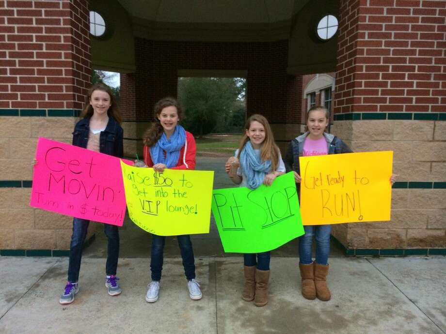 Students Skyler Knight, Madi Claire McCollum, Lauren Pittilo and Brooke Ashton rally the troops in front of Cryar Intermediate for the school's annual Get Movin' fundraiser.