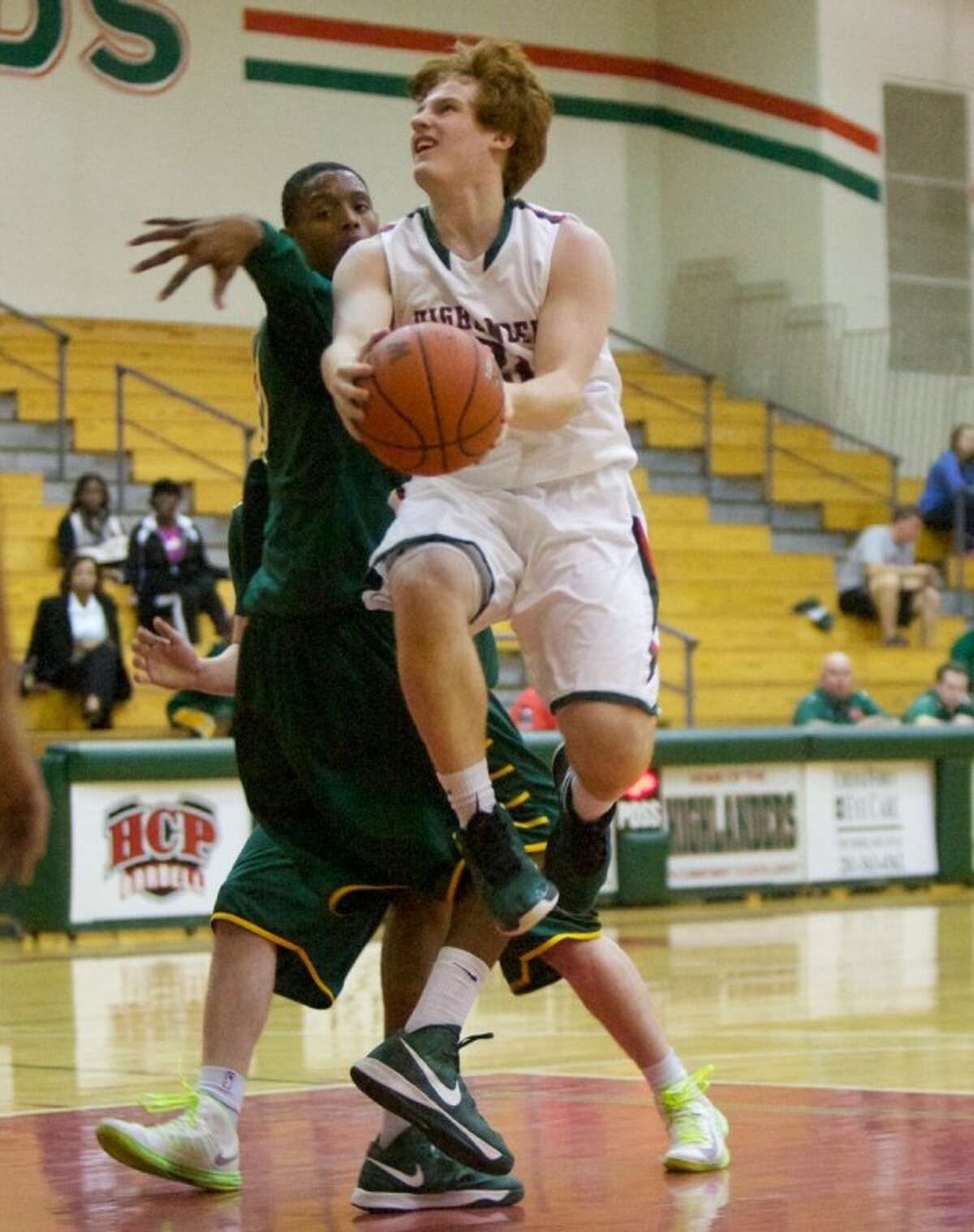 The Woodlands' Zach Manning goes up for a basket during Friday night's non-district game at The Woodlands High School.