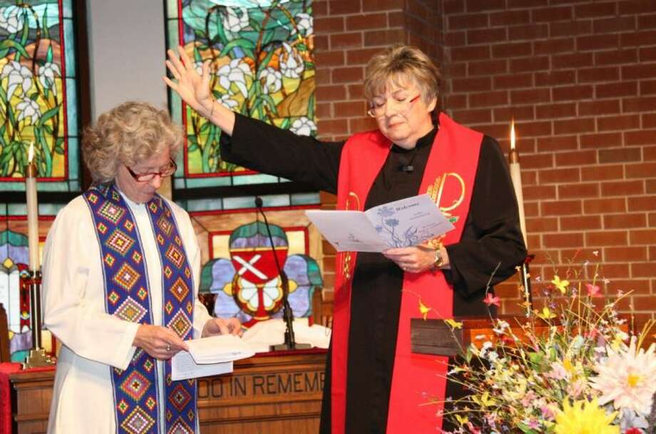 Rev. Hope Attenhofer, left, is installed as pastor of First Christian Church in Conroe during the installation ceremony Sunday afternoon.