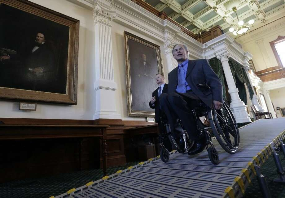 Texas Gov. Greg Abbott exits the Senate Chamber using a temporary ramp Jan. 5 in Austin. Photo: Eric Gay