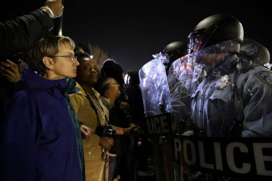Police and protesters square off outside the Ferguson Police Department on Wednesday. Photo: Jeff Roberson