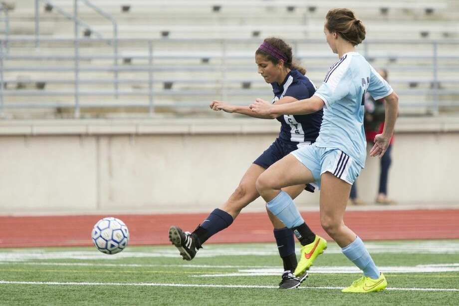 College Park's Isa Sanabria (22) shoots at the goal during Kingwood's 2-0 victory over College Park on Friday at Turner Stadium in Humble.