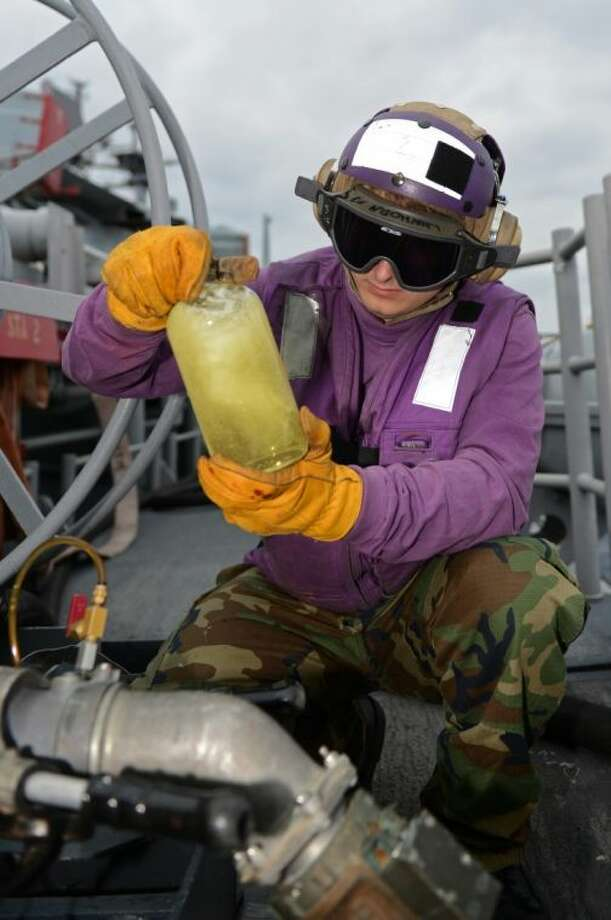 Aviation Boatswain's Mate (Fuels) Airman Dylan Nunez, from Conroe, conducts a fuel clarity and brightness test with flushed JP 5 fuel March 3 somewhere in the East China Sea aboard the forward-deployed amphibious assault ship USS Bonhomme Richard (LHD 6). The Bonhomme Richard is the flagship of the Bonhomme Richard Amphibious Ready Group, and with the embarked 31st MEU, is currently conducting joint force operations in the U.S. 7th Fleet Area of Responsibility. Photo: Mass Communication Specialist 2n
