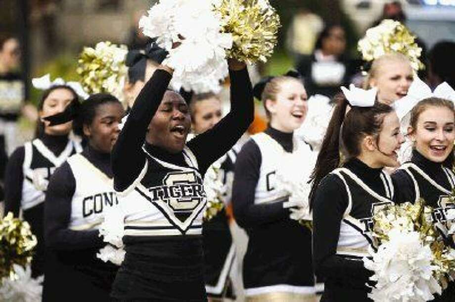 Conroe High School cheerleaders march in the Black History Month Parade on Saturday in Conroe. To view more photos from the parade and award ceremony, go to HCNPics.com. Photo: Michael Minasi