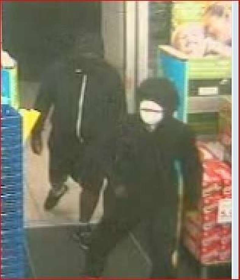 The police are searching for two males after they allegedly robbed a Walgreens in The Woodlands Monday morning.