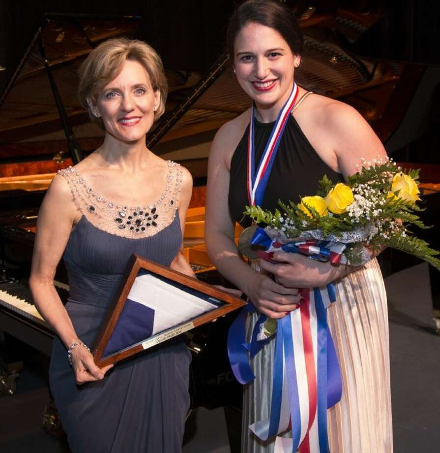 Susie Pokorski, chairman and executive director of Young Texas Artists Music Competition, left, and 2014 Grand Prize award winner, mezzo-soprano Allegra De Vita. De Vita was named the winner of the competition at the conclusion of the Finalists' Concert & Awards Saturday at the Crighton Theatre.