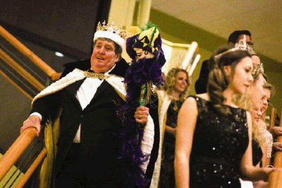 Mardi Gras King Corky Shaw descends the staircase during Montgomery County Performing Arts Society's 7th Annual Mardi Gras Ball. Photo: Michael Minasi