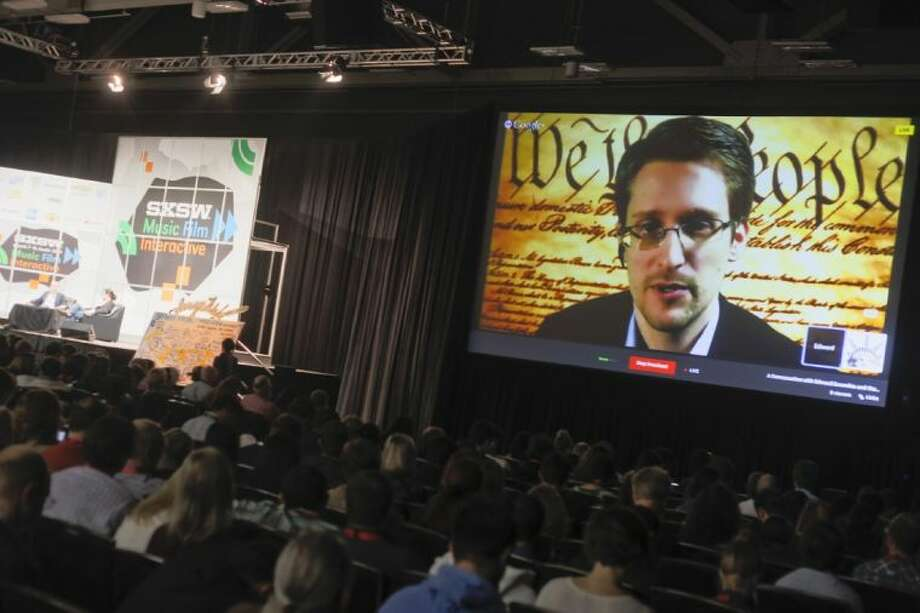 Edward Snowden talks during a simulcast conversation during the SXSW Interactive Festival on Monday, March 10, 2014, in Austin, Texas. Snowden talked with American Civil Liberties Union's principal technologist Christopher Soghoian, and answered tweeted questions. Photo: Jack Plunkett