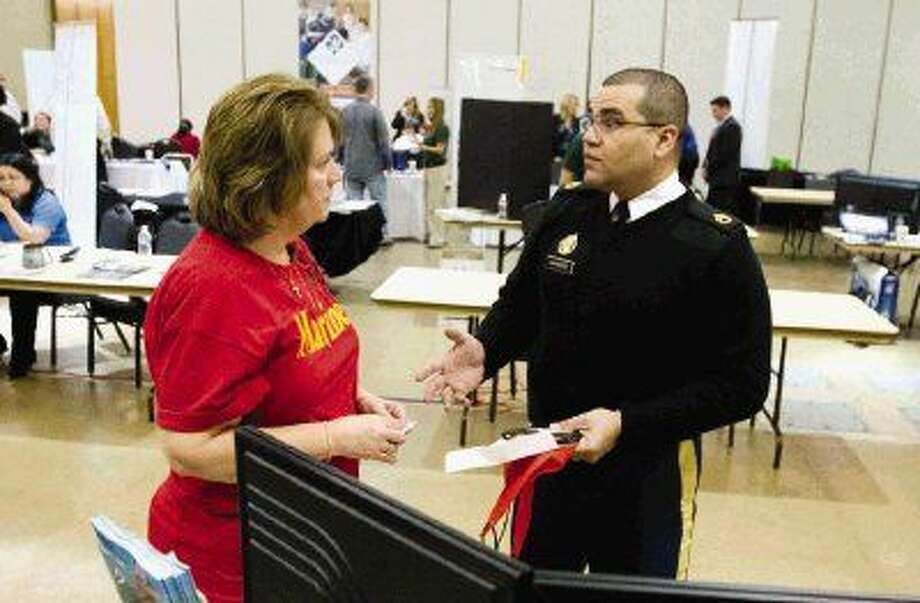 Army recruiter Sgt. Milton Marrero talks with Peggy Suarez, of The Woodlands Township, during a veteran's expo and hiring event Tuesday, March 17.