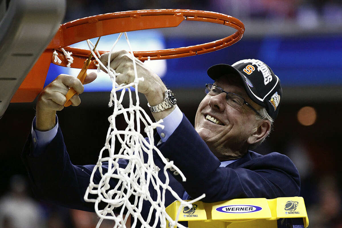 FILE - In this March 30, 2013, file photo, Syracuse head coach Jim Boeheim cuts down the net after the East Regional final against Marquette in the NCAA men's college basketball tournament in Washington. Syracuse university officials say coach Boeheim will retire in three years and athletic director Daryl Gross has resigned following punishment from the NCAA for violations that lasted more than a decade. Chancellor Kent Syverud said Wednesday, March 18, 2015, that Boeheim, a Hall of Famer and head coach for 39 years, decided to make the announcement to