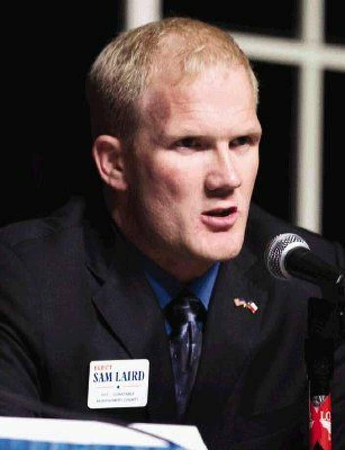 Sam Laird, candidate for Precinct 1 Constable, speaks during a candidate forum for various local, state and national races at the Crighton Theatre Wednesday, Dec. 16, 2015, in Conroe. Photo: Jason Fochtman