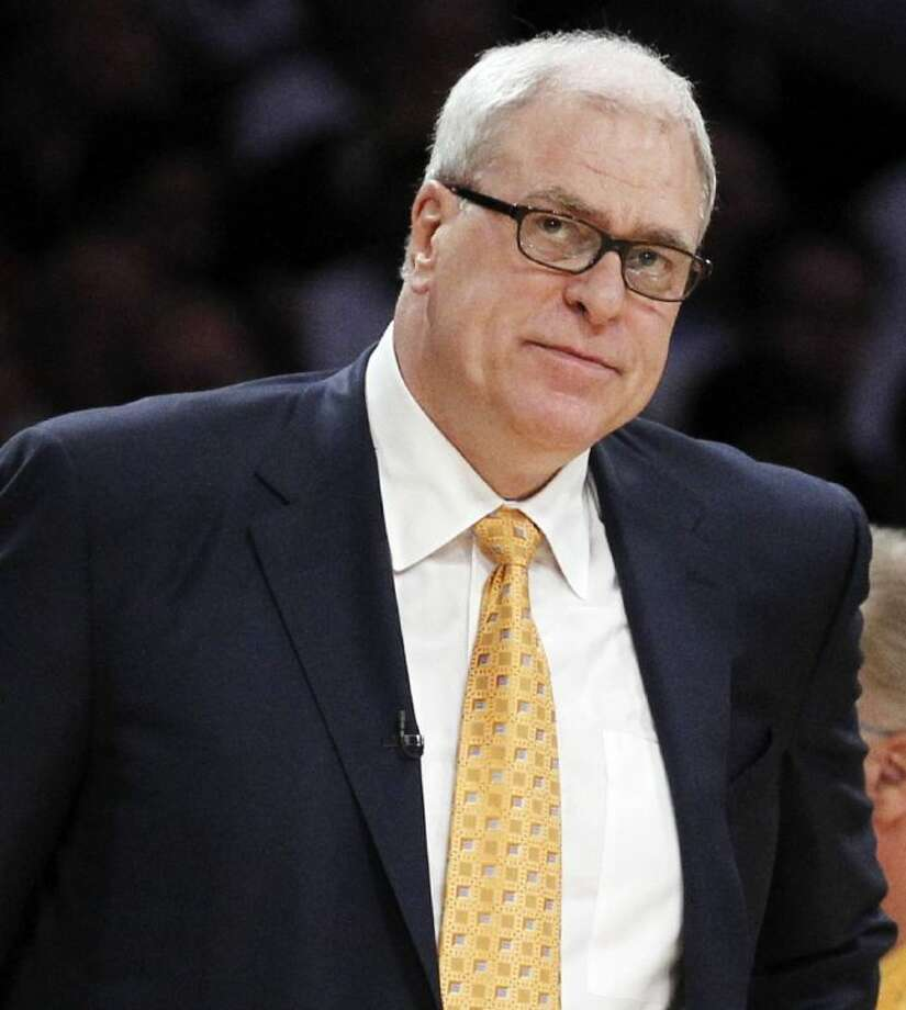 Former Los Angeles Lakers coach Phil Jackson — pictured during the first half of Game 2 of the NBA finals against the Boston Celtics on June 6, 2010, in Los Angeles — may soon be joining the New York Knicks. Photo: Chris Carlson