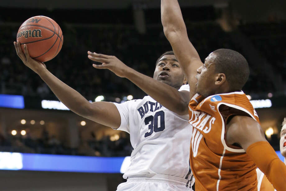 Butler's Kelan Martin (30) shoots over Texas's Jonathan Holmes (10) during the second half in the second round of the NCAA college basketball tournament, Thursday, March 19, 2015, in Pittsburgh. (AP Photo/Gene J. Puskar) Photo: Gene J. Puskar