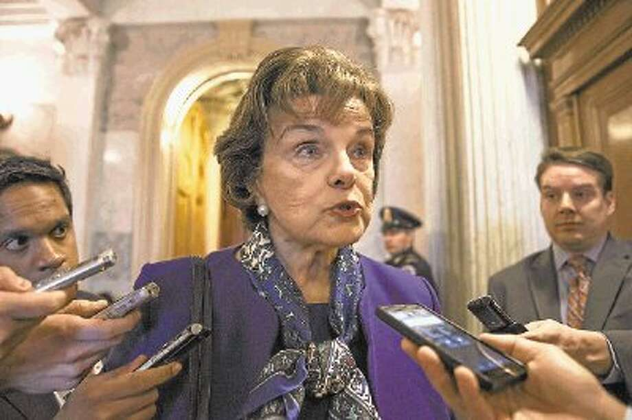 Senate Intelligence Committee Chair Sen. Dianne Feinstein, D-Calif. talks to reporters as she leaves the Senate chamber on Capitol Hill in Washington, Tuesday. Photo: J. Scott Applewhite / @WireImgId=2666841