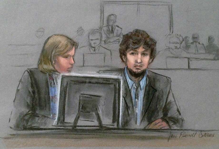 In this courtroom sketch, Dzhokhar Tsarnaev, right, and defense attorney Judy Clarke are depicted watching evidence displayed on a monitor during his federal death penalty trial Monday, March 9, 2015, in Boston. Photo: Jane Flavell Collins