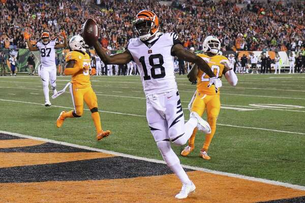 Cincinnati Bengals wide receiver A.J. Green (18) scores a touchdown during the first half of an NFL football game against the Miami Dolphins, Thursday, Sept. 29, 2016, in Cincinnati. (AP Photo/Gary Landers) ORG XMIT: OHJM120