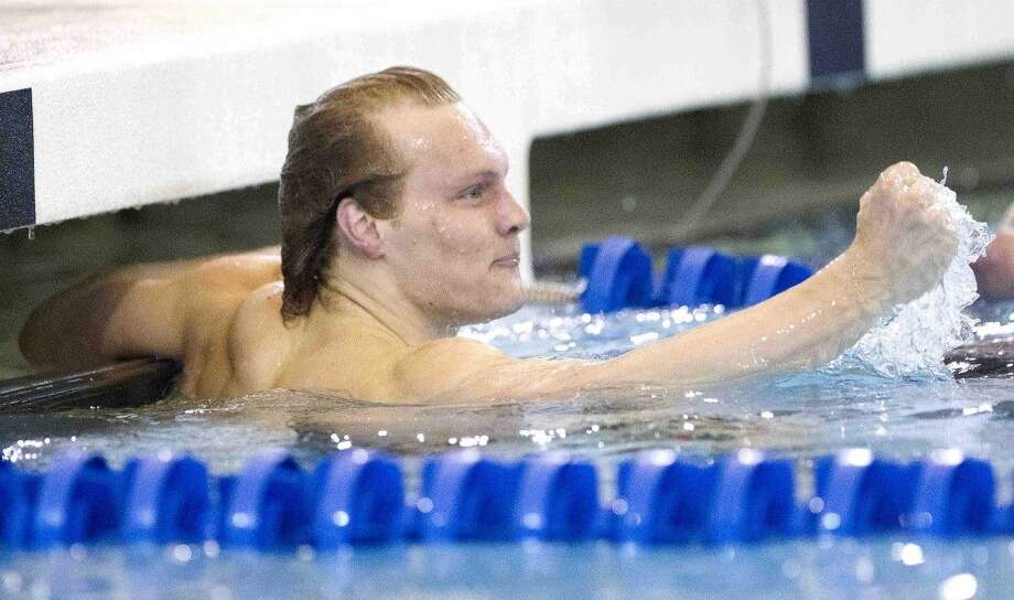 Kenyon's Harrison Curley celebrates after finishing first and setting a new NCAA record in the finals of the men's 200-yard backstroke during NCAA Division III Swimming & Diving Championships Saturday. Go to HCNpics.com to view more photos from the meet.