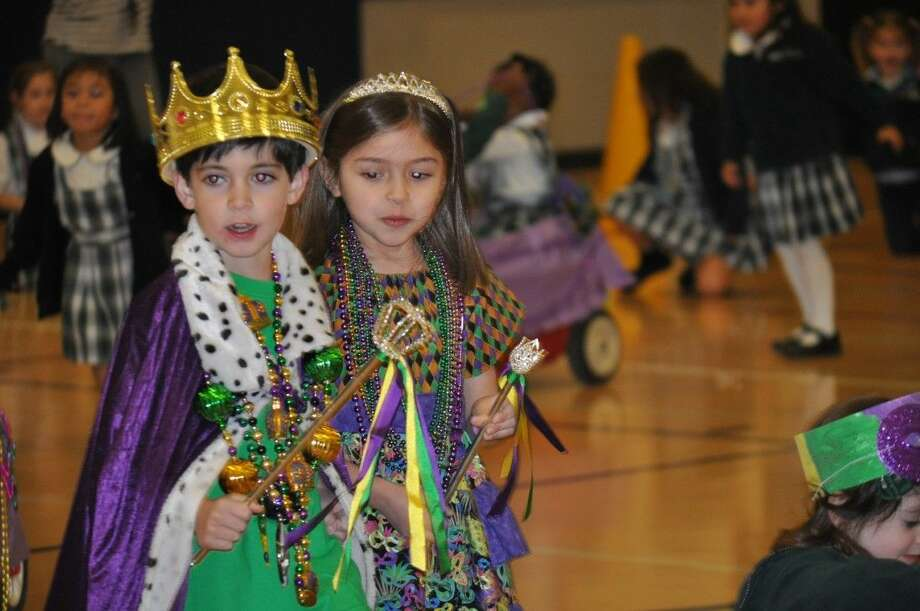 Kindergarten students, Nicolas Velardo and Lana Lease, led the Early Childhood Mardi Gras parade as King and Queen at St. Anthony of Padua Catholic School.