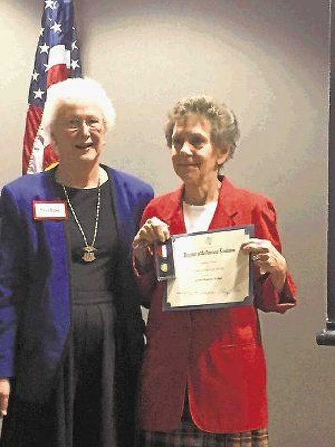 Presenting the award is Ann Wohl, MMDAR member (left) and Carolyn Walker (right), also MMDAR member. Photo: Submitted