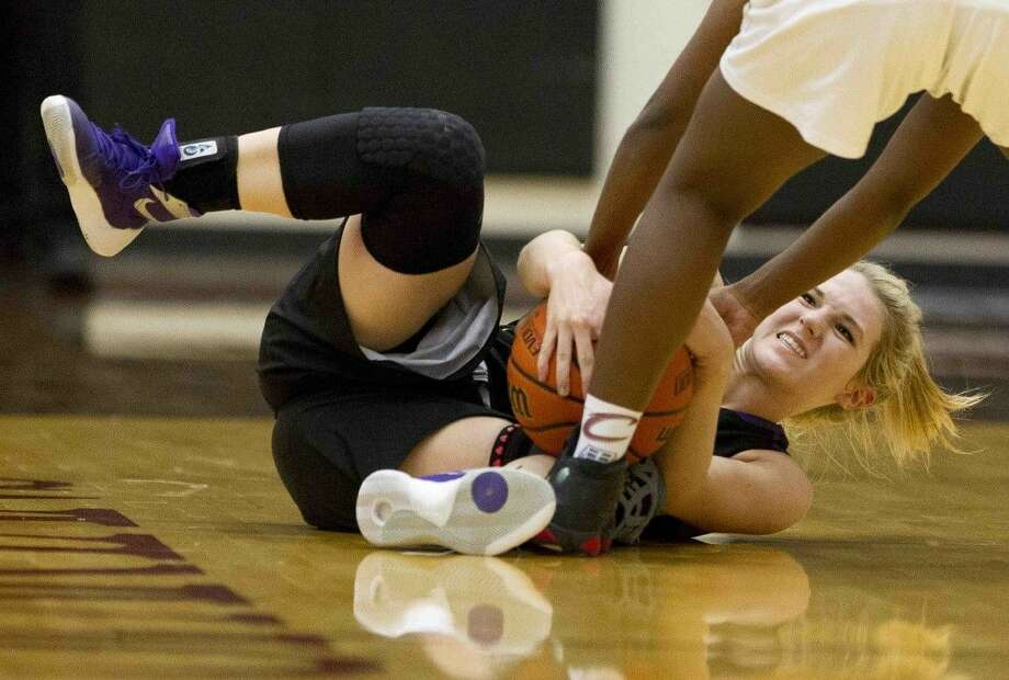 Montgomery guard Taylor Barroso fights for a loose ball during the third quarter during Tuesday. Photo: Jason Fochtman