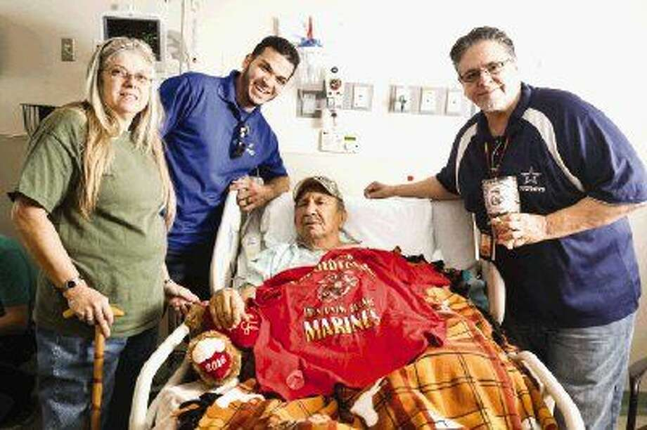 Marine Corps veteran Bobby Diaz, center, is visited by fellow veterans Marti Raney, Marcus Brown and Armando Galarza while recovering from a stroke on Monday at Memorial Hermann The Woodlands Hospital.