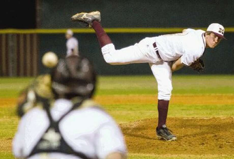 Magnolia West's Justin Yoss pitches during a District 18-4A game against Magnolia on Friday. The Mustangs won 9-3. To view or purchase this photo and others like it, visit HCNpics.com. Photo: Staff Photo By Ana Ramirez / The Conroe Courier