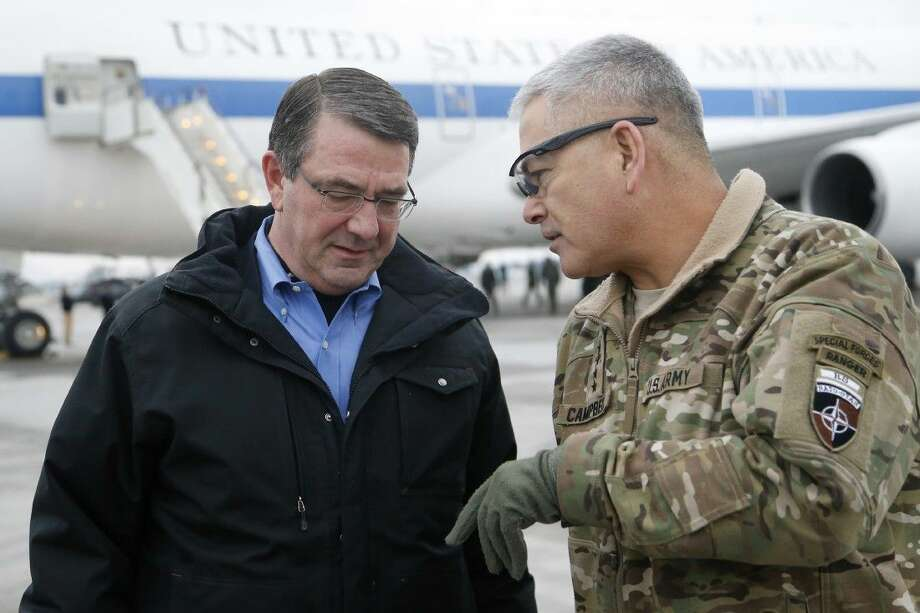 In this Feb. 21, file photo, U.S. Secretary of Defense Ash Carter, left, walks with U.S. Army Gen. John Campbell upon arrival at Hamid Karzai International Airport in Kabul, Afghanistan. The pace of U.S. troop withdrawals from Afghanistan will headline Afghan President Ashraf Ghani's visit to Washington. Photo: Jonathan Ernst