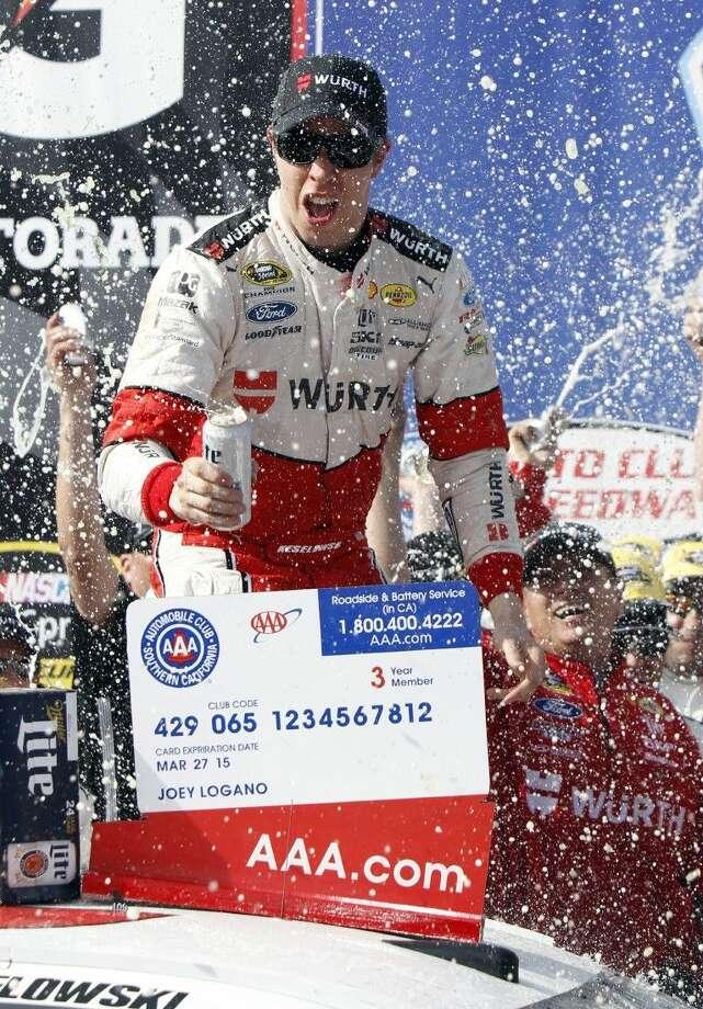 Brad Keselowski celebrates winning the NASCAR Sprint Cup Series auto race in Fontana, Calif. Photo: Alex Gallardo