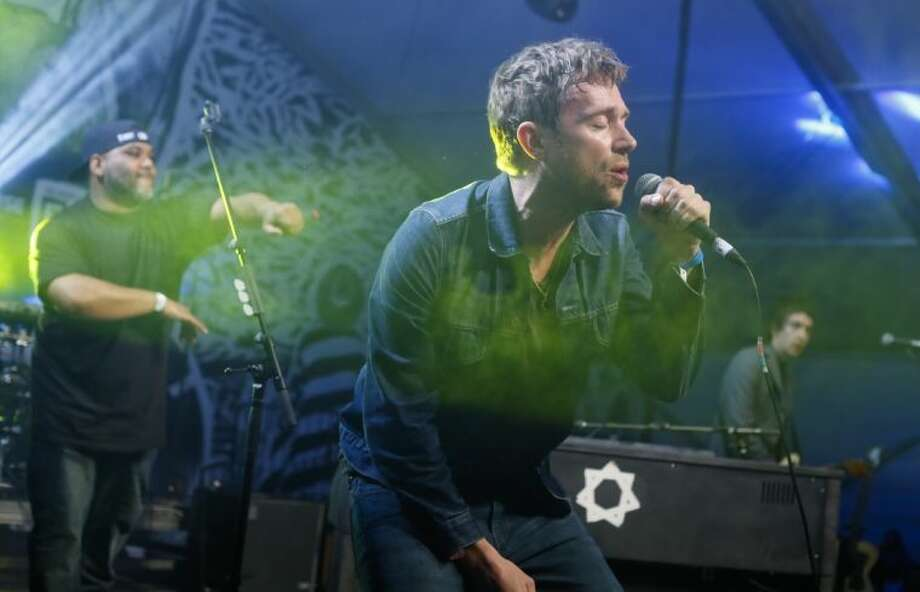Damon Albarn, right, joined by De La Soul's Vincent Mason, left, performs during the SXSW Music Festival Friday in Austin. Photo: Jack Plunkett
