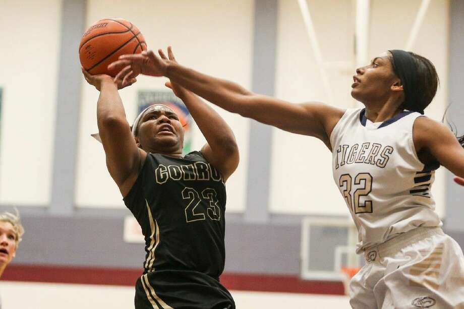 Conroe's Erica Solomon-Powell (23) shoots for the basket as Klein Collins' Natalya Chatham (32) defends during the high school girls basketball game on Monday at College Park High School. Photo: Michael Minasi