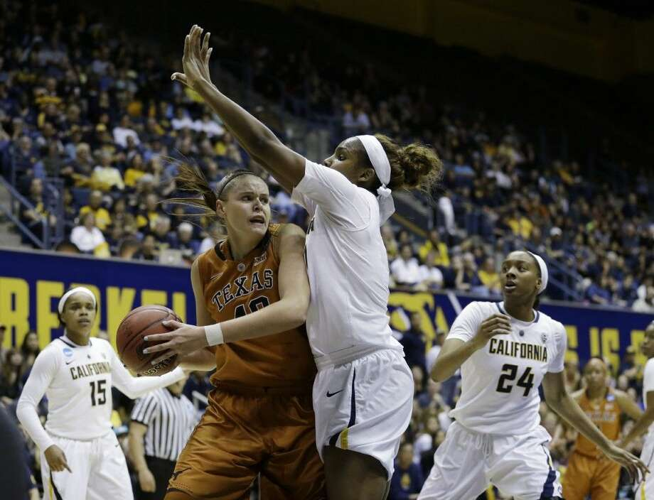 Texas center Kelsey Lang, left, looks for a teammate against Cal. Photo: Marcio Jose Sanchez