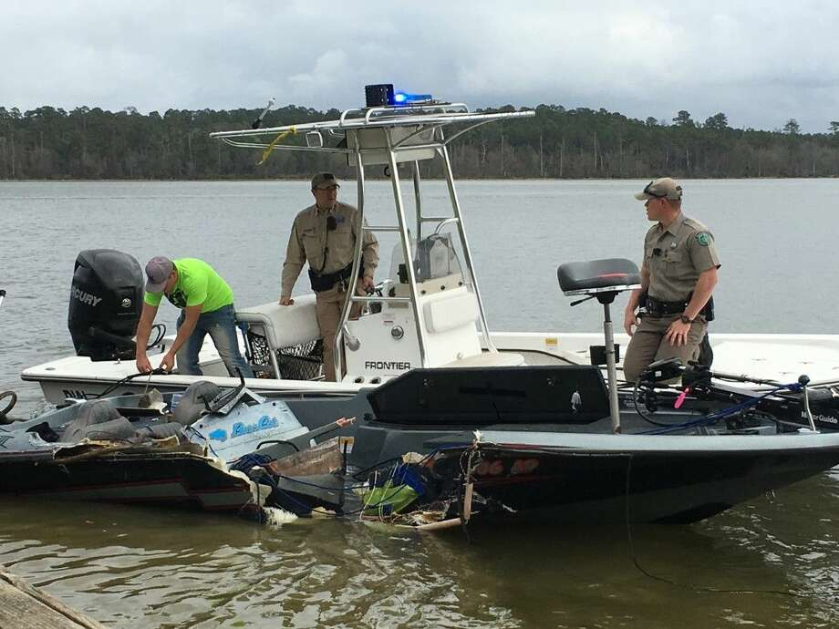 Law enforcement officials remove a damaged boat from the water Saturday morning after two fishing boat collided. One man was killed in the accident.