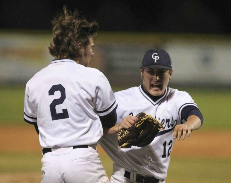 College Park pitcher Beau Ridgeway celebrate after the final out of a District 16-6A baseball game against The Woodladnds Tuesday. Photo: Jason Fochtman