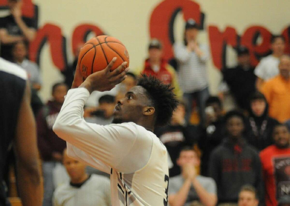 Conroe's Marcus Keyser shoots the go-ahead free throw in overtime in a District 16-6A play-in game against College Park at Caney Creek High School on Saturday.